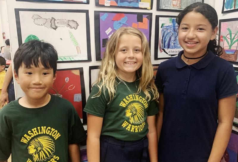 Three Washington elementary students pose for a picture.