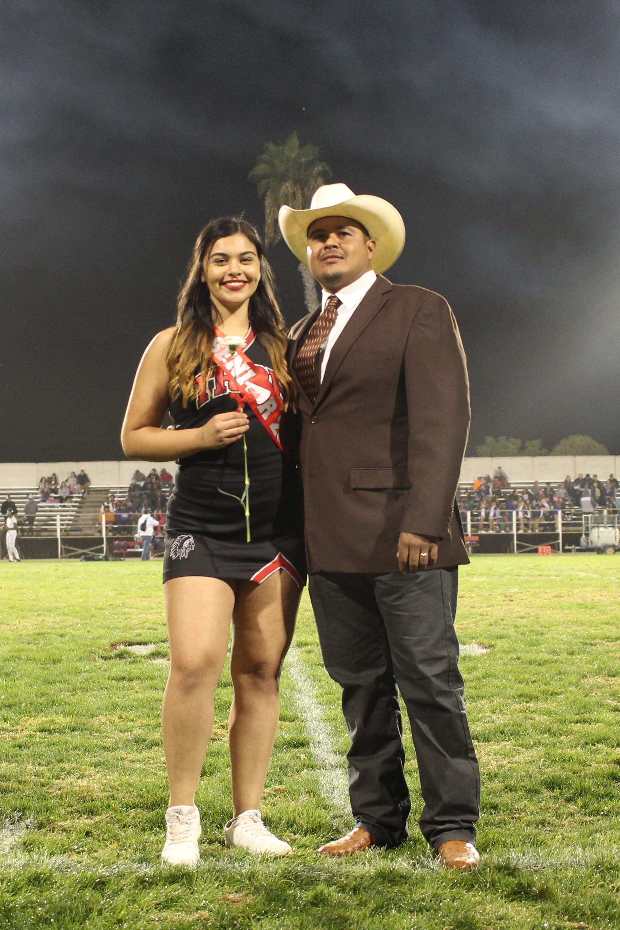 Senior cheerleader Fatima Benavides and her escort.