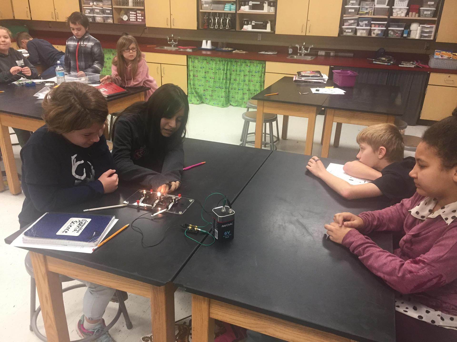students exploring closed and open circuits