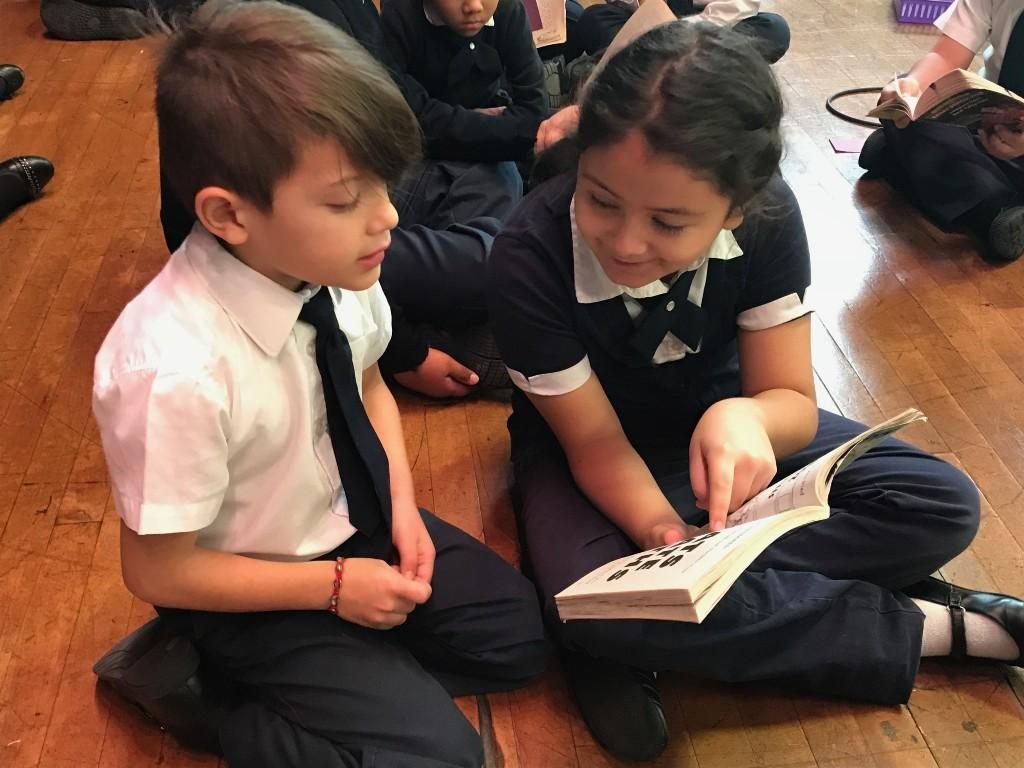 Students reading in the gym