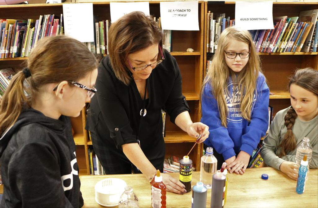 Photo of McKinley 4th graders working on SEL project with librarian.