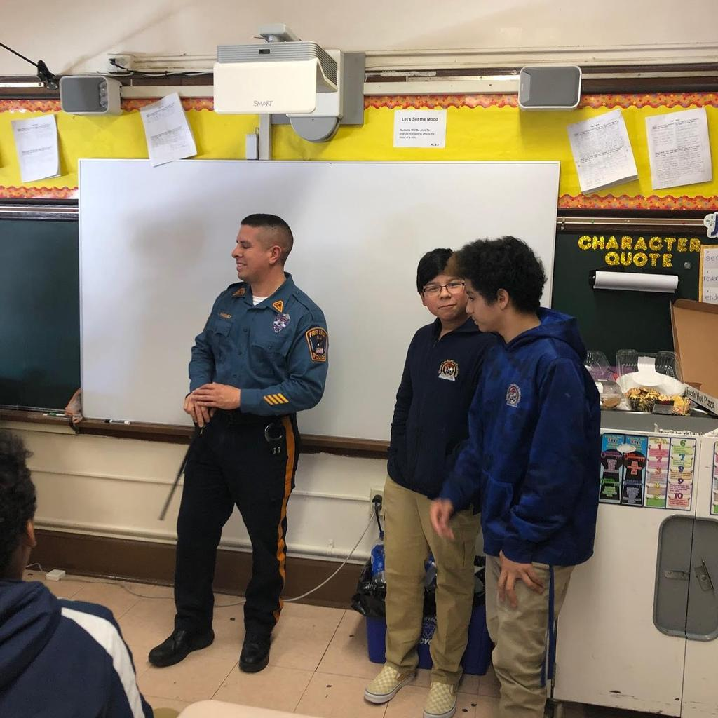 officer Vasquez with two male students