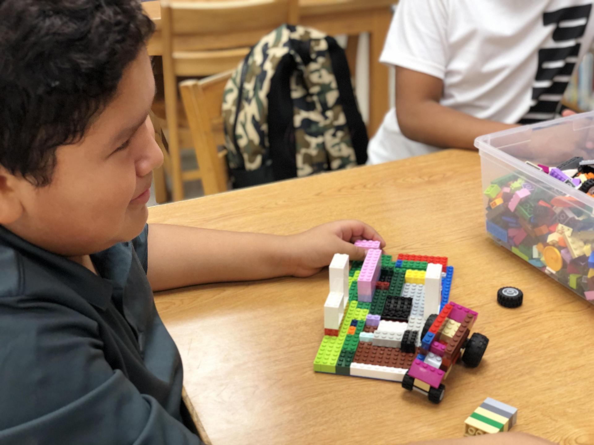 Student with Legos