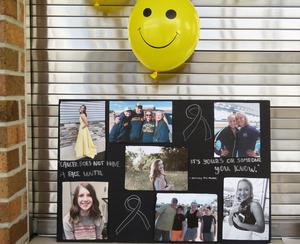 The poster made by Ebbie Appel shows the faces of cancer - including her father, Brian, and classmate Lydia Cole.