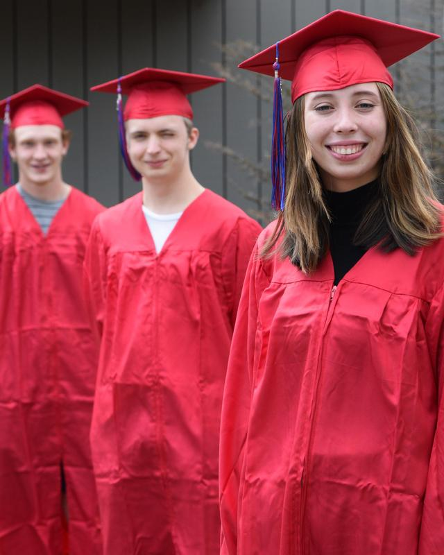 valedictorians in caps and gowns