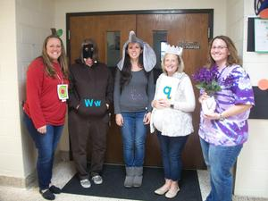 Teachers and instructional assistants dressed as Letterland characters.