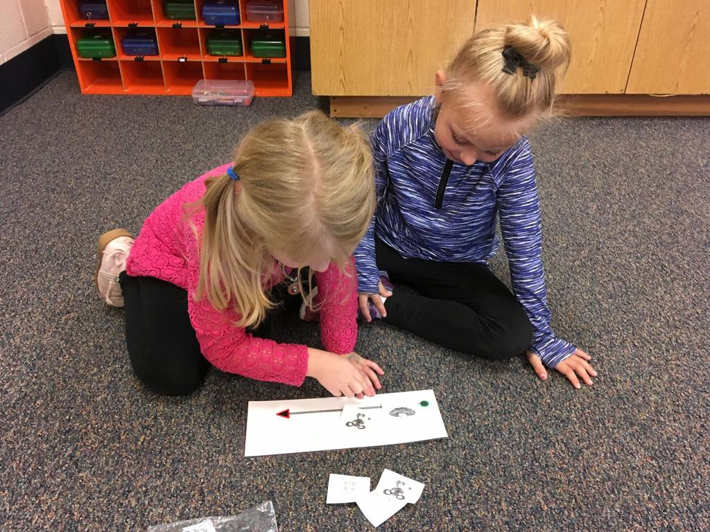 Students in Mrs. Estebez' kindergarten class practice a phonological awareness activity with a partner in preparation for learning to read.