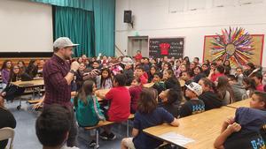 photo of students enjoying Josh Drean assembly