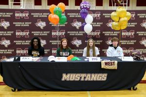 Four students from Magnolia West High School signed National Letters of Intent on Wednesday, Feb. 5