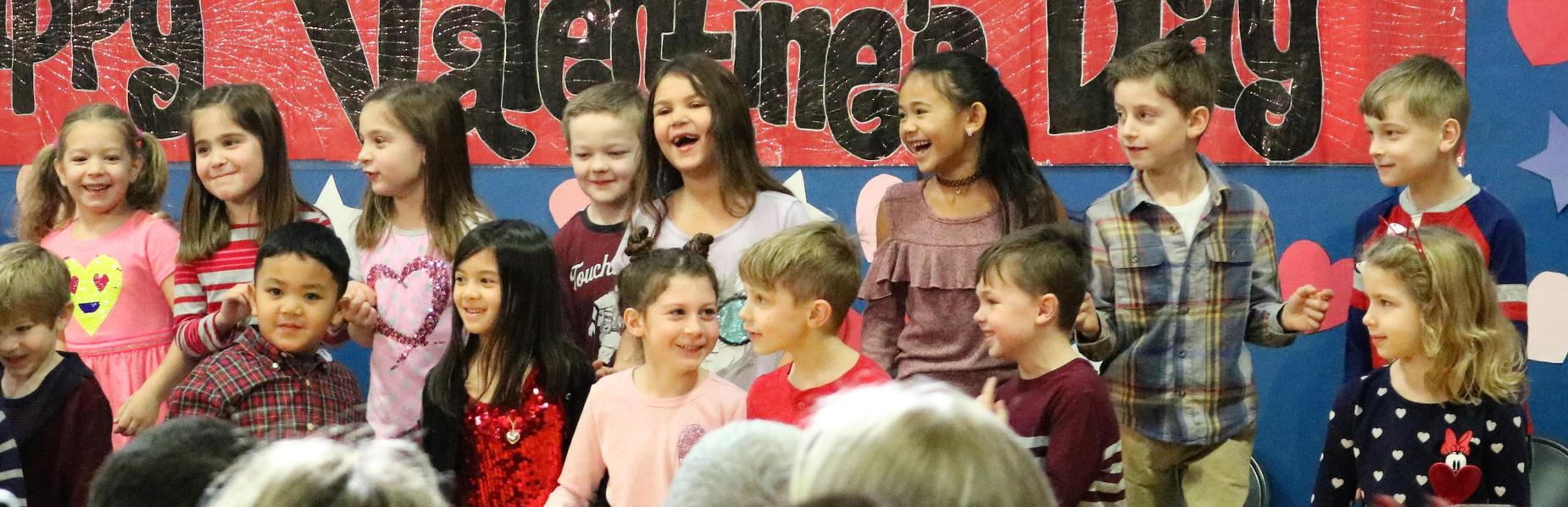 1st graders enjoy a Valentine's Day singalong at Washington School.