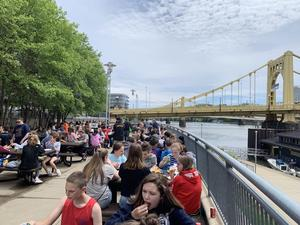 Kids eating by river at PNC park