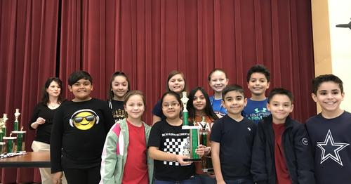 chess students posing with trophy