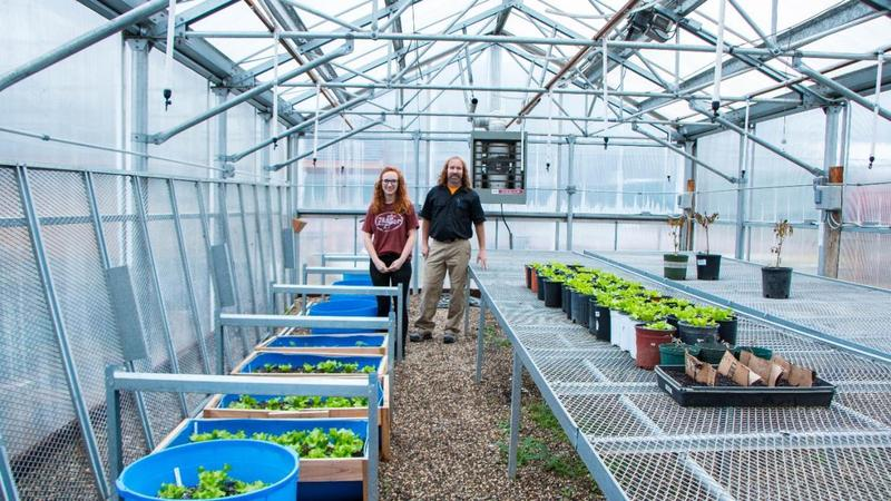 Teacher Dan Brown and Student in the GHS Greenhouse