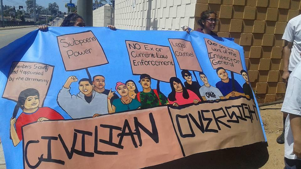 students from Boyle Heights holding a sign for civilian oversight