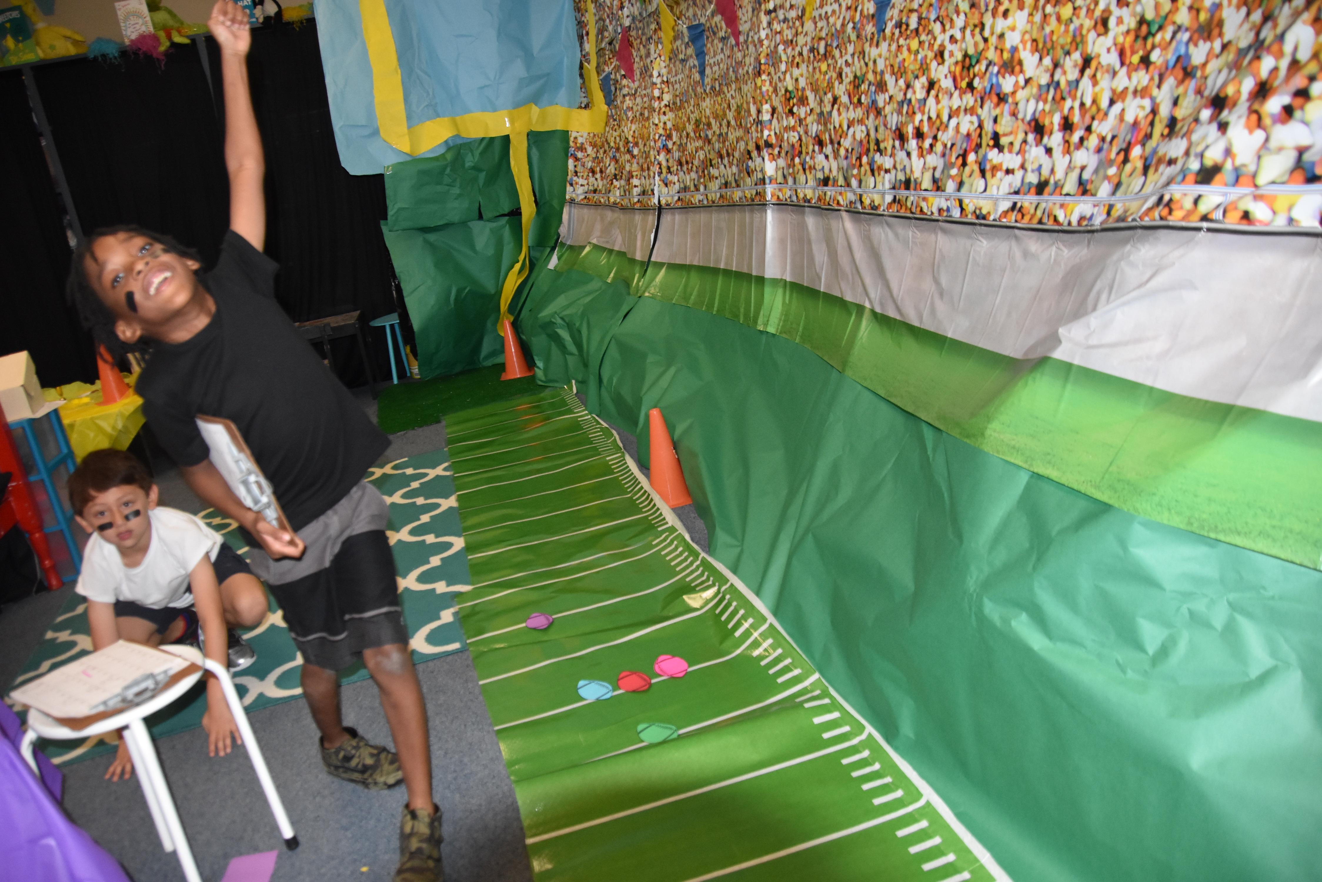 "Blue Haze Elementary first graders recently attempted to earn touchdowns while reviewing place value content. Teachers ""flipped"" their classrooms to give students the feel of a stadium setting for the lesson."