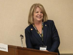 Dr. Melissa Moore at Podium 2019.png