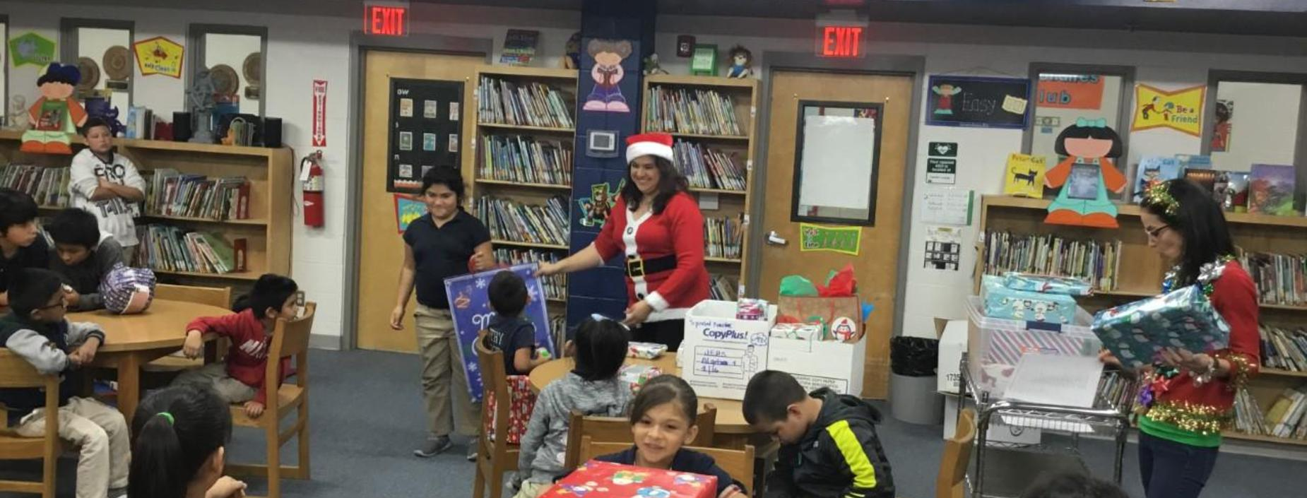 Image of Principal passing out gifts.