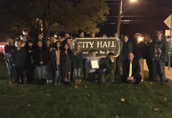 Members of the band pose in front of Somers Point City Hall