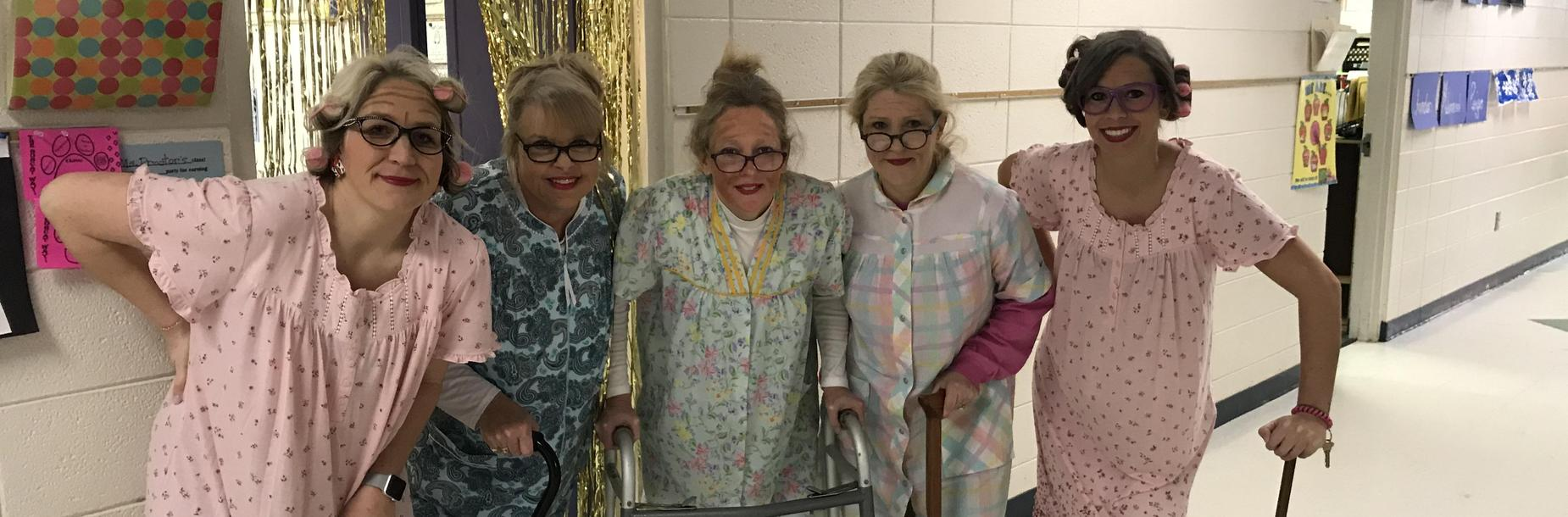Teachers posed for picture dressed up as the elderly in celebration of 100 days of school