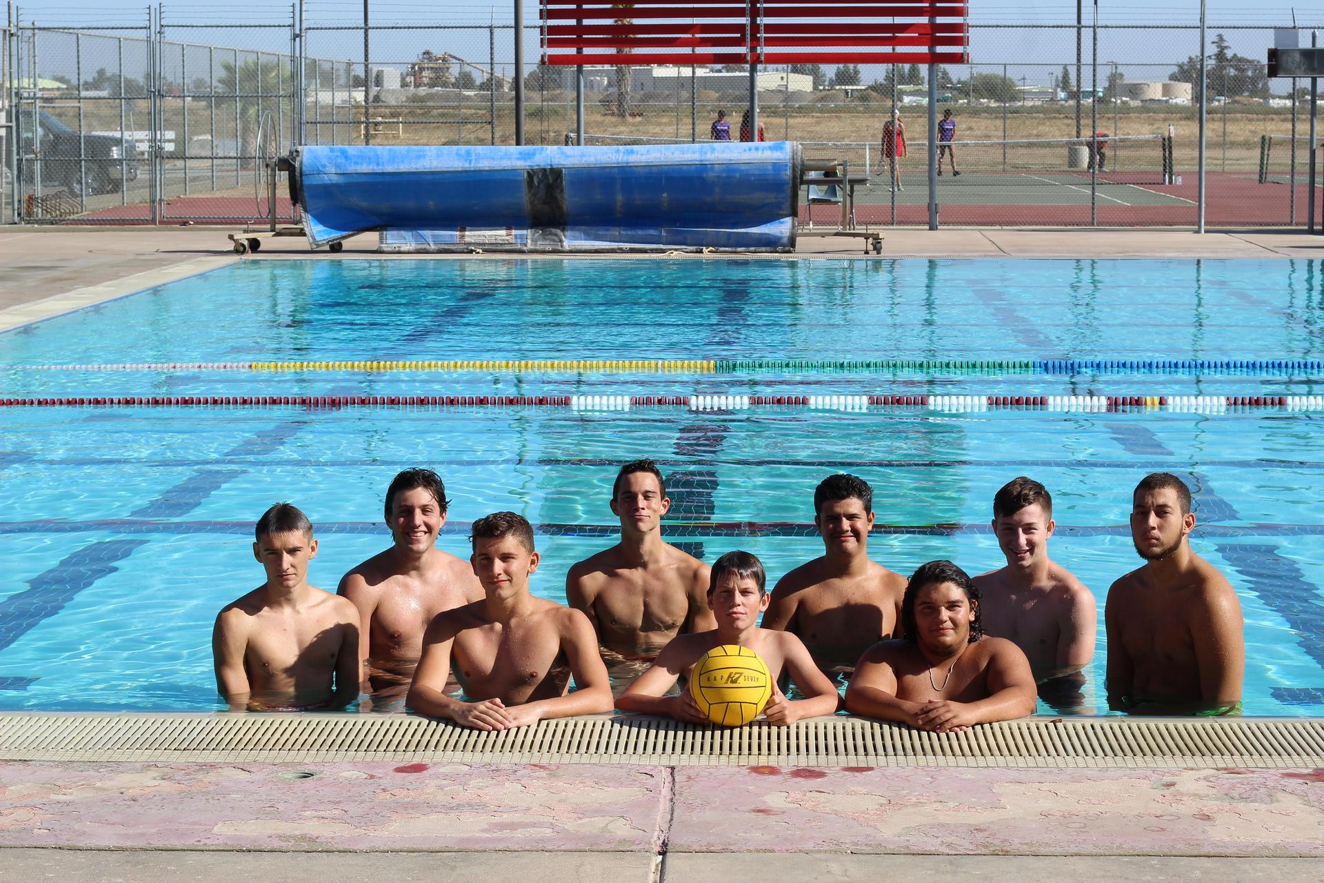 Boys water polo team posing