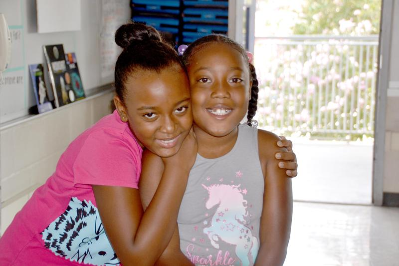 Two female students pose for a photo