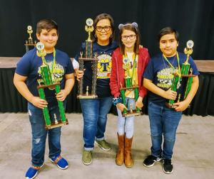 The Truman Chess Team and Coach pose with trophies.