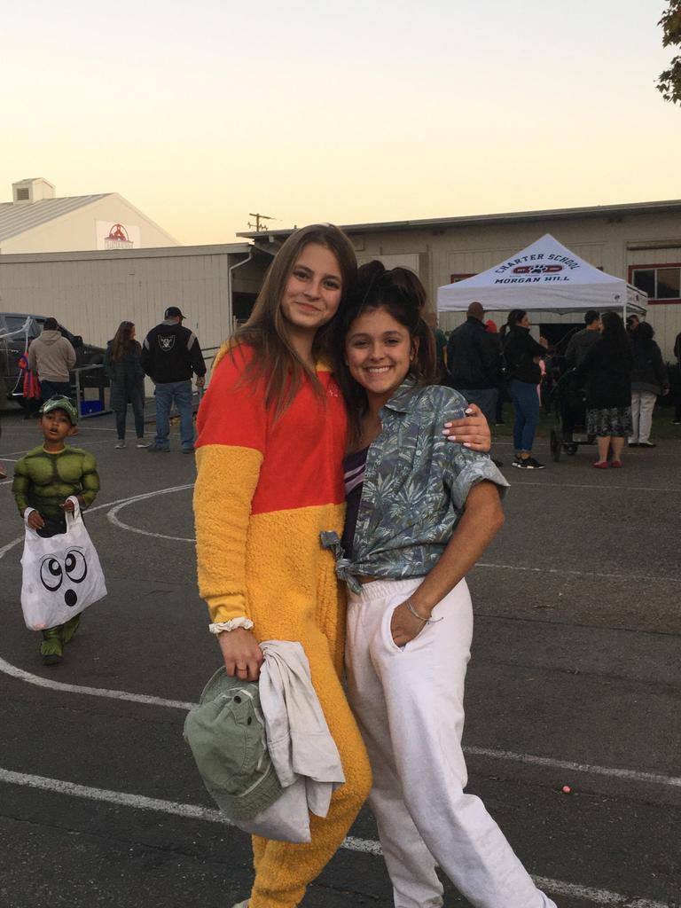 girls dressed as winnie the pooh