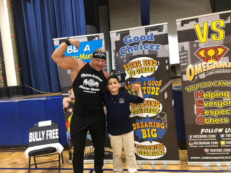 anti-bullying presenter Omegaman with young boy