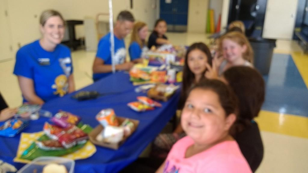 Mrs. Grant, AP and Mr. Broecker, Principal with the 4th grade winners of Lunch with the Principal August 25, 2017