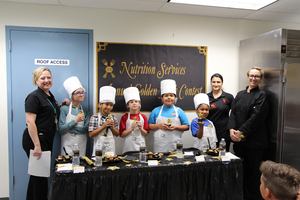SJUSD's 2018 Golden Fork Recipe Contest winners (L-R) Director Tammy White, Wyatt Goodwin (North Mountain Middle), Jorge Luna (Cope Elementary), Gregory Broder (Record Elementary), Izabella Gallardo (Cope Elementary), Aznill Jimenez (Park Hill Elementary), Lead Production Assistant Annieta Silva and Chef Angela Phalen.