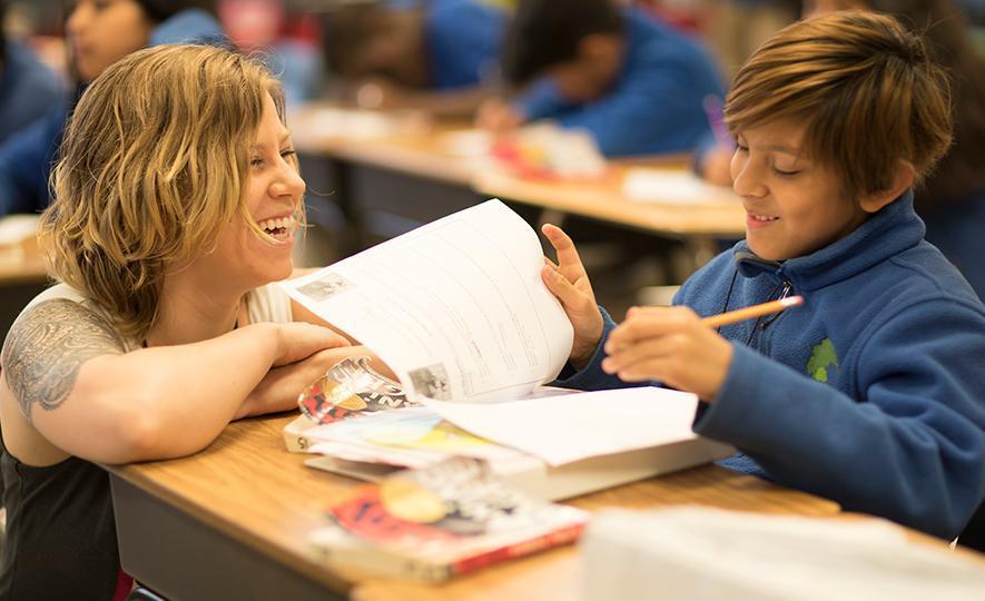 """Middle school teacher and student in Minneapolis, Minnesota"""