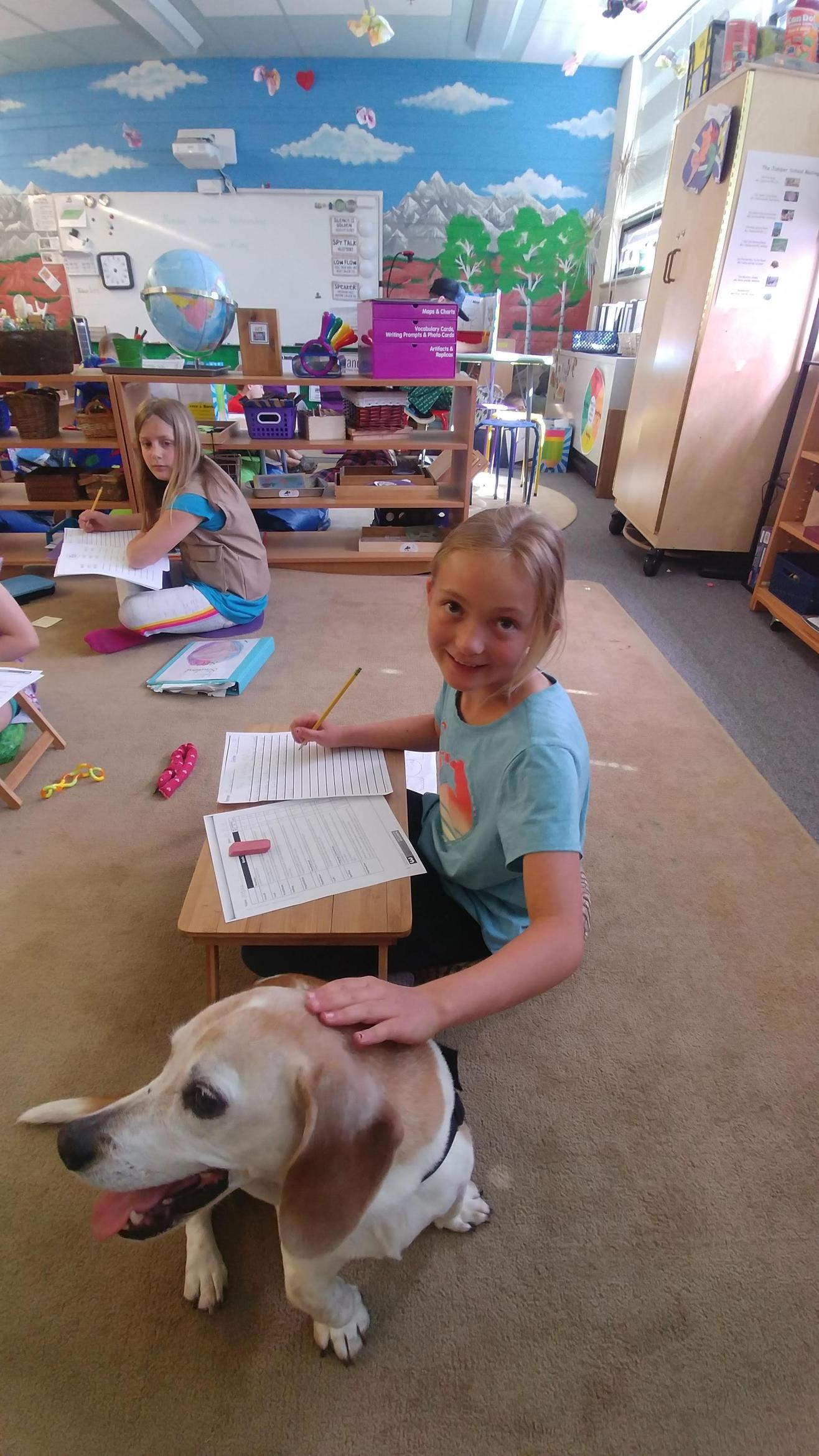 Cricket the dog doing work with the kiddos