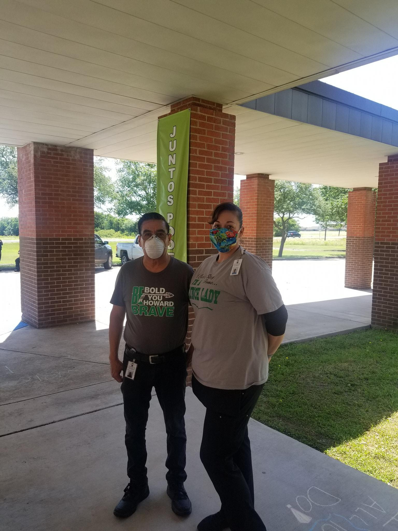 2 employees wearing face masks