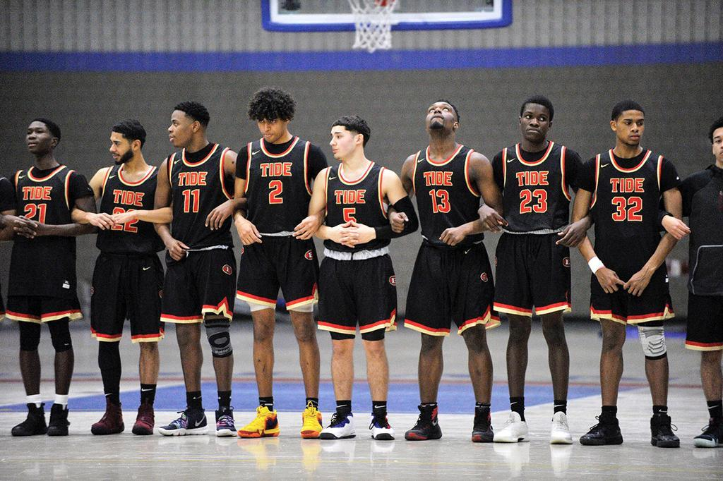 Boys Basketball Players Line Up for the National Anthem