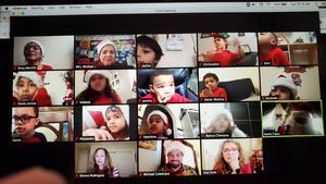 Class wearing Santa hats on zoom