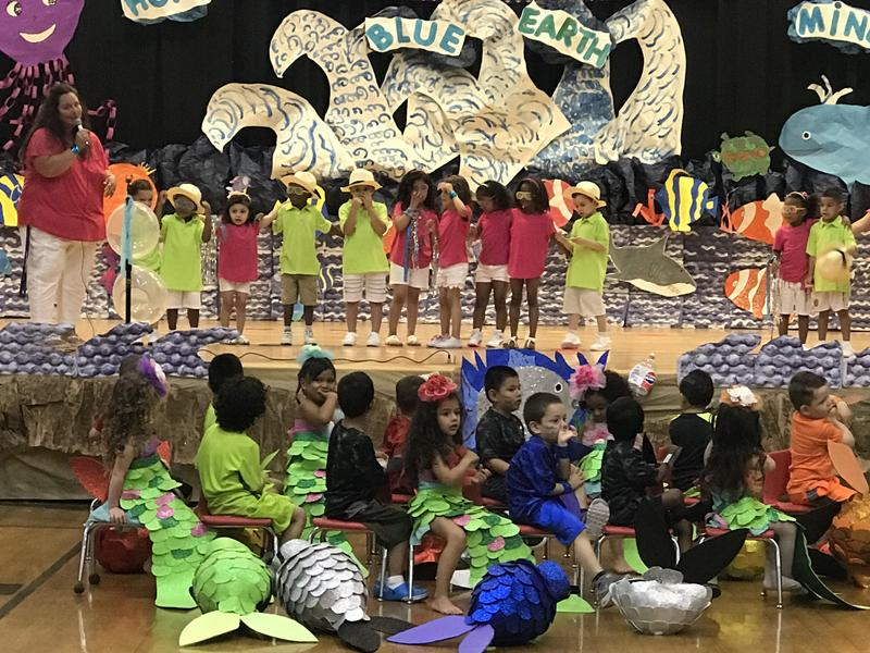 pre-k students singing and dancing