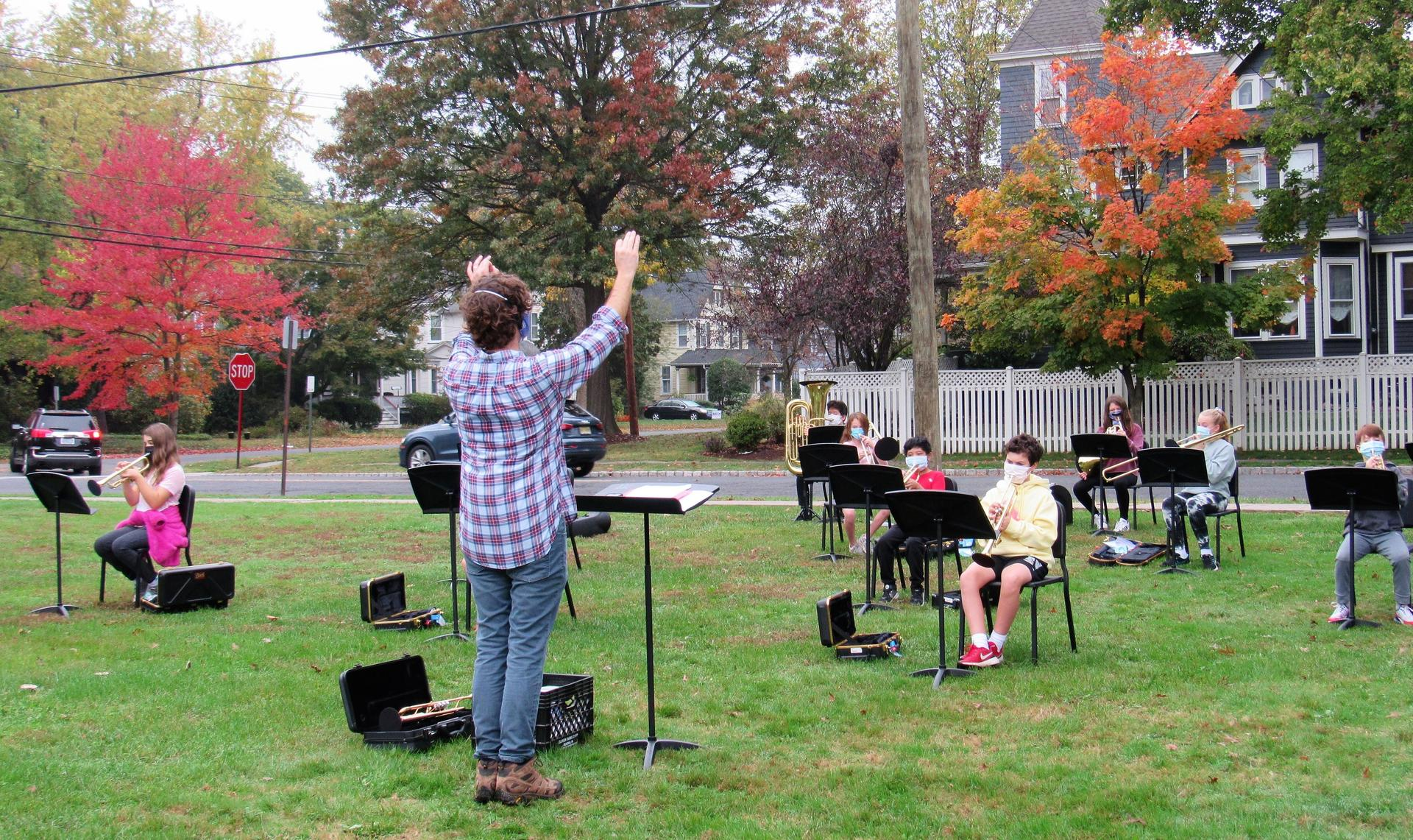 Photo of RIS band director conducting class outside during COVID