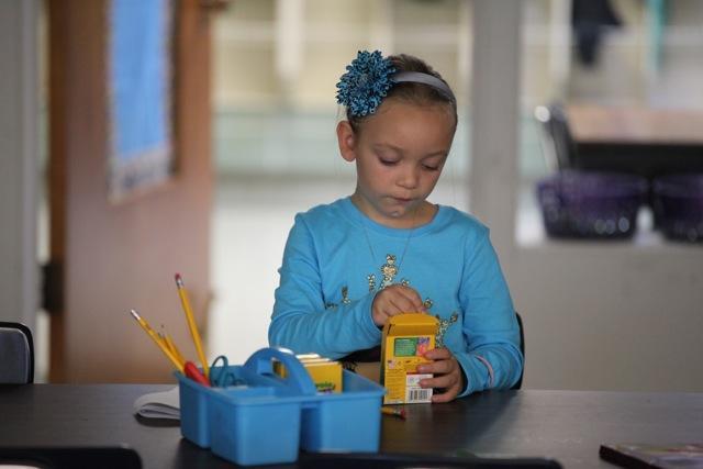 girl choosing crayon