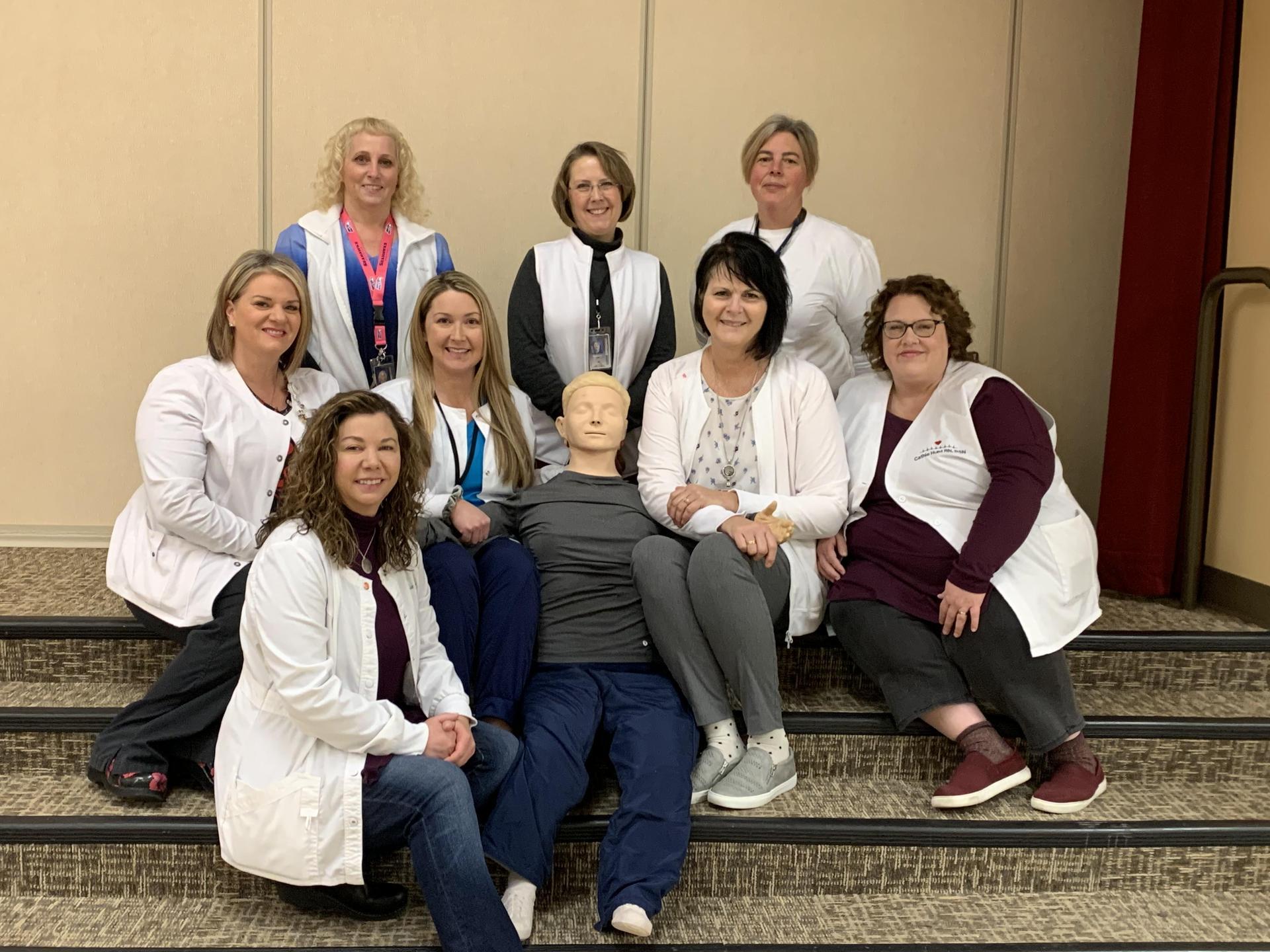 2020 MLSD School Nurses group photo around a medical test dummy.