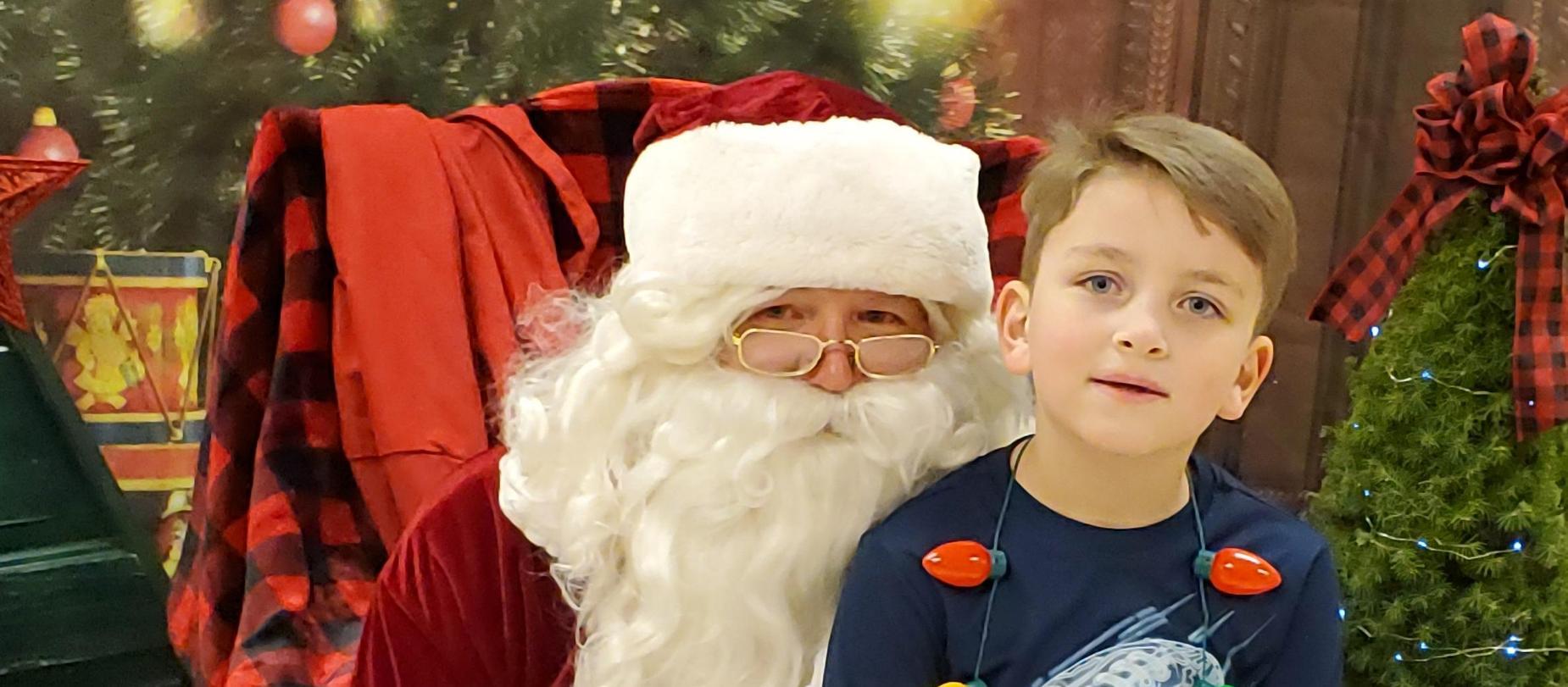 student sitting on Santa's lap