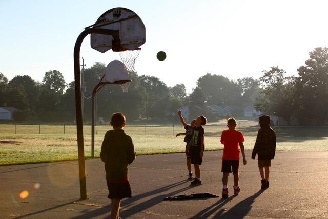 kids playing basketball in morning