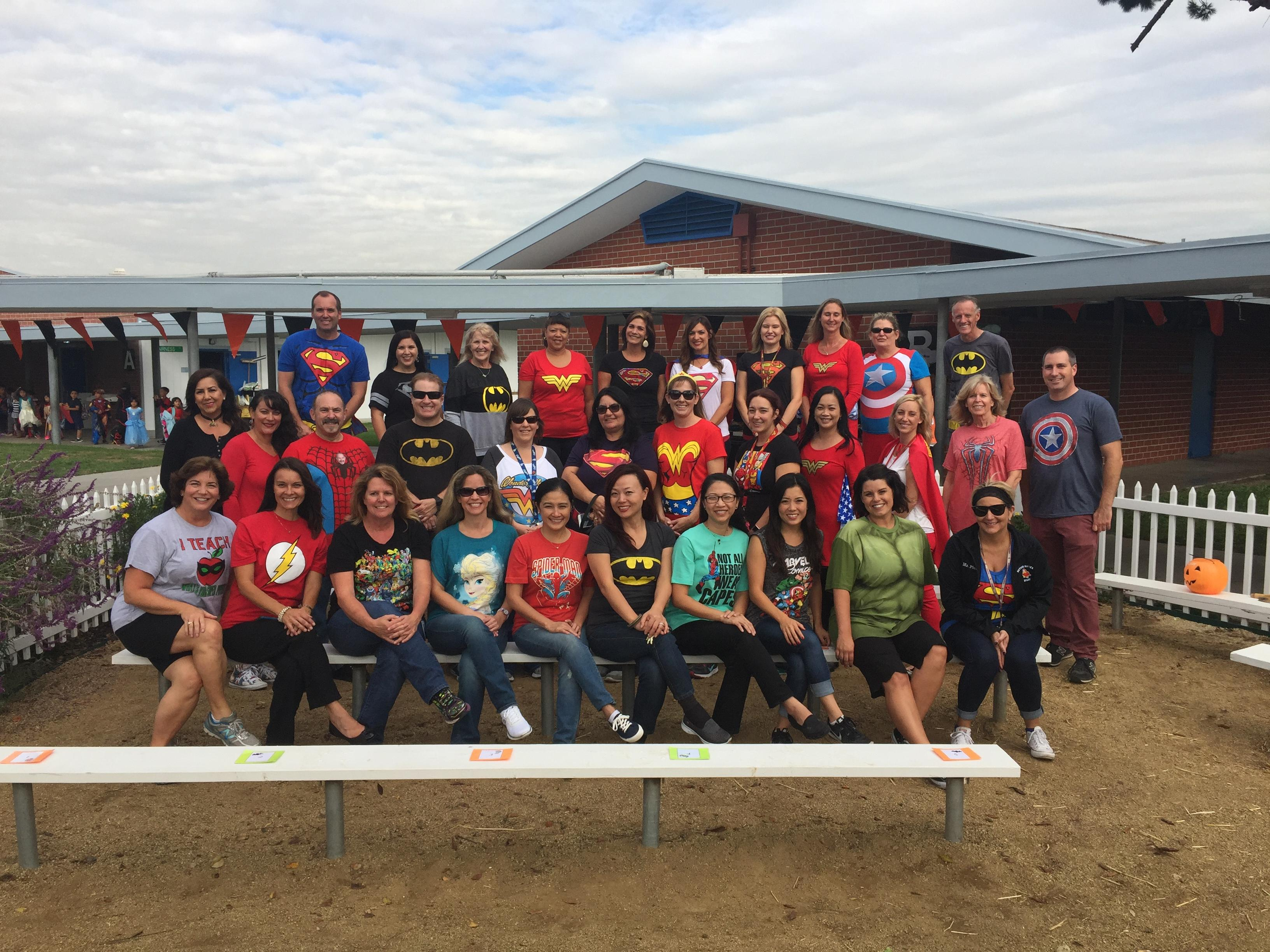 The Hayden staff wearing super hero shirts, posing in the reading garden.