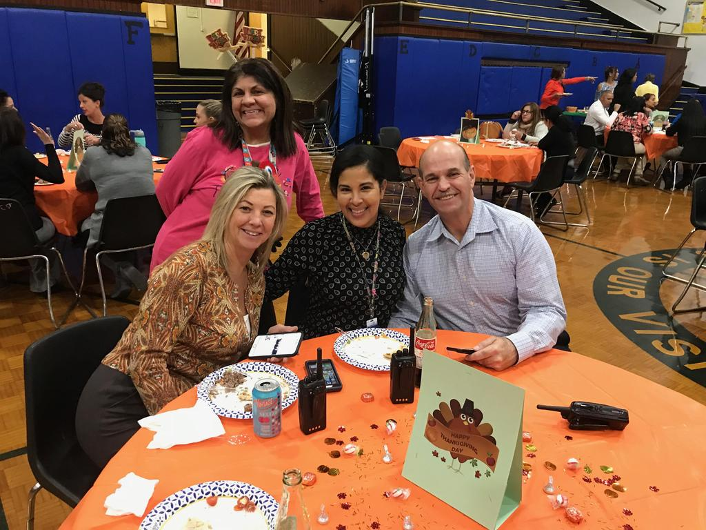 Edison Admin sitting at the table together