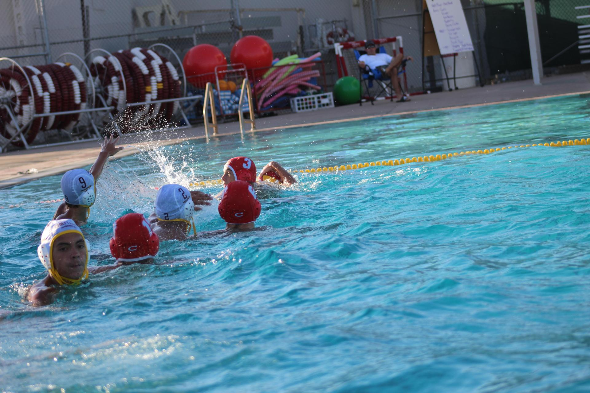 Boys playing water polo against Sierra
