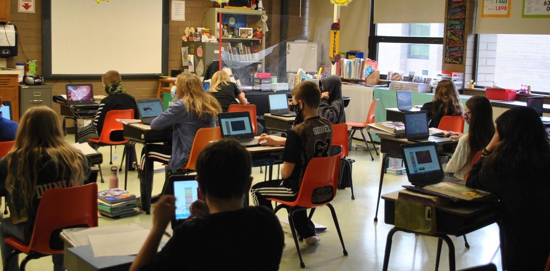 classroom of students working on Chromebooks