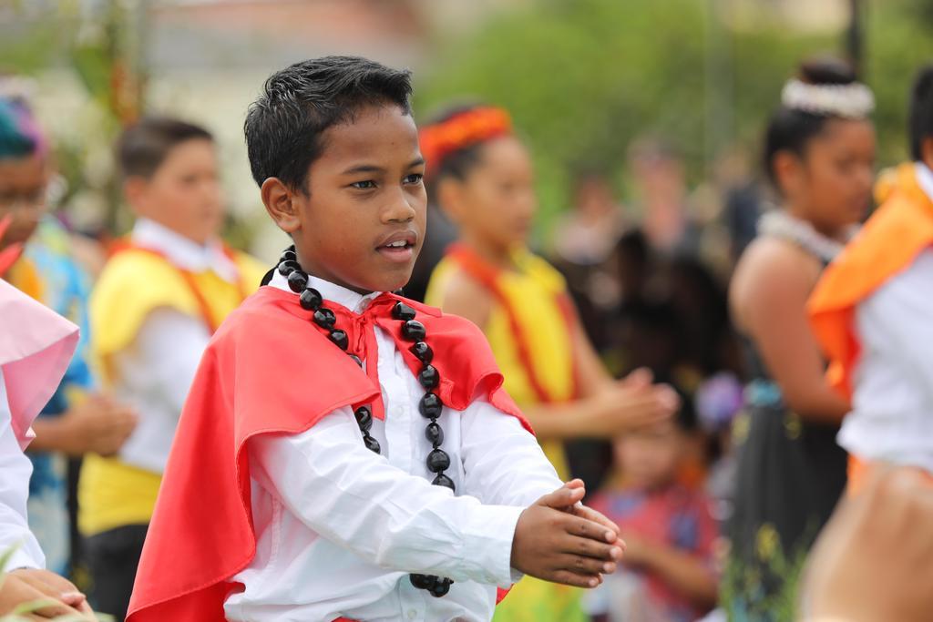 spear bearer dancing hula