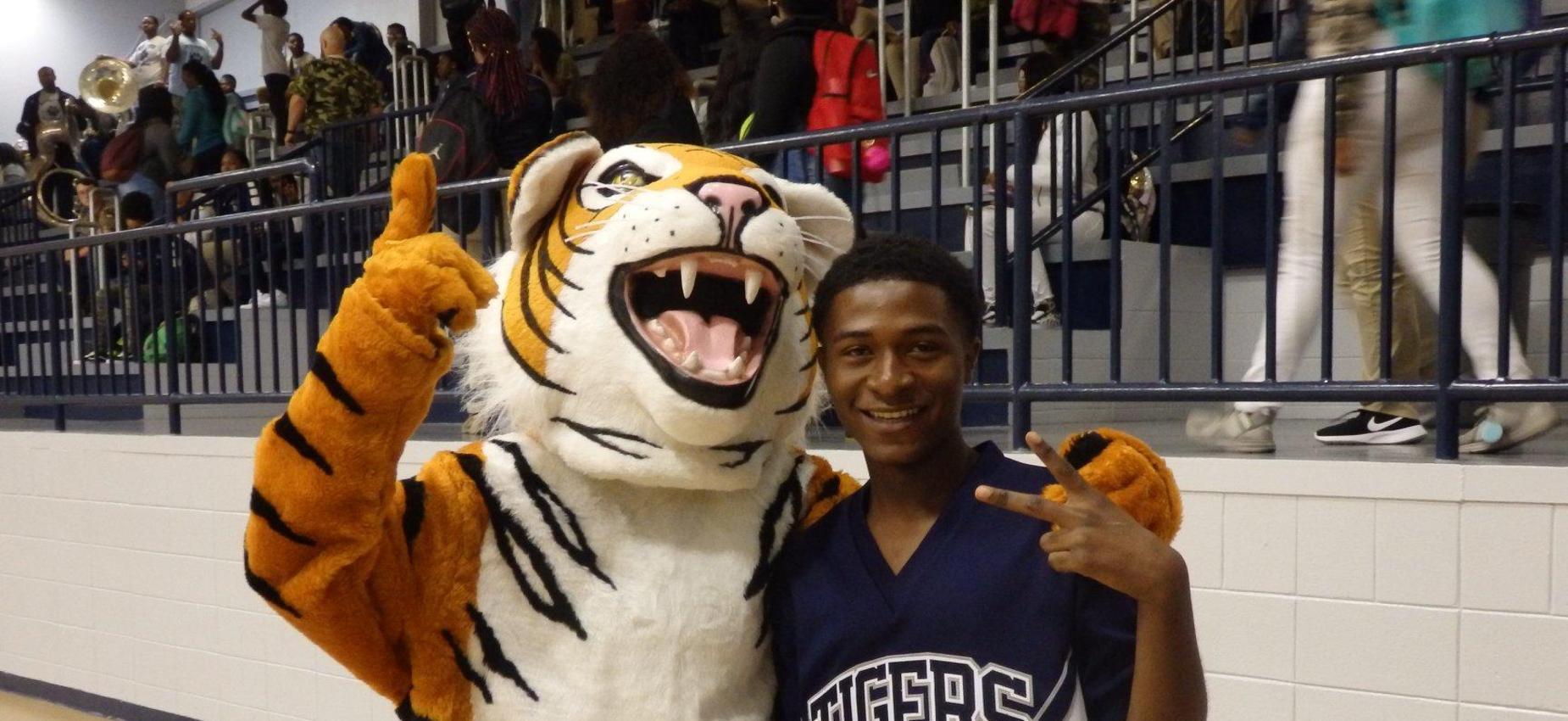tiger mascot and cheerleader male