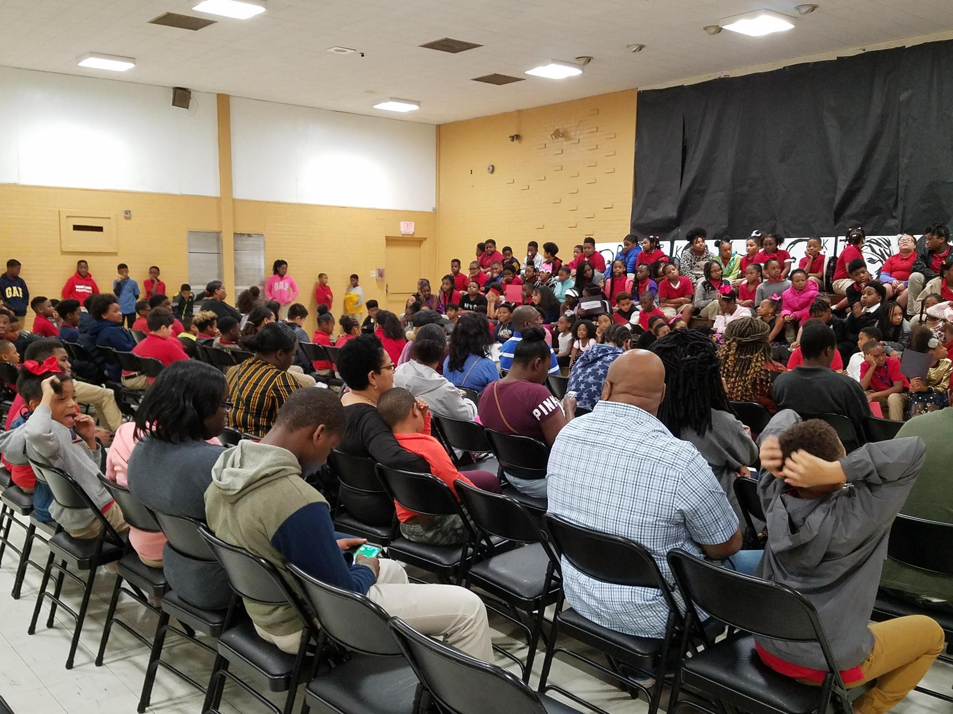 a photo of Mrs. Candace Bailey giving closing remarks at the end of the Bakerfield/Baker Heights 2019 Black History Program