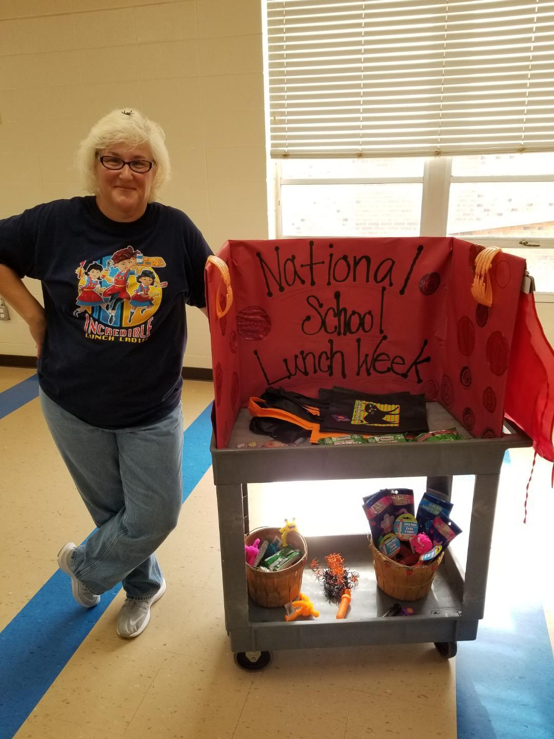 HANDING OUT PRIZES FOR NATIONAL SCHOOL LUNCH WEEK