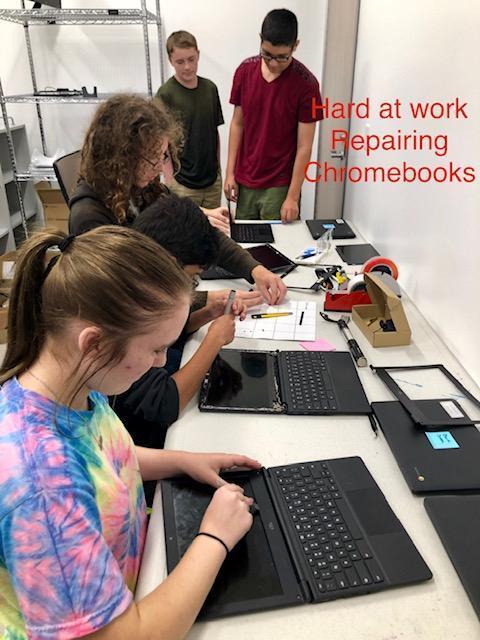 students repairing computers
